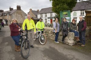 Pictured, from left, activities providers Carl Percival and Richard Haggerty on their bikes, with Jane Clough, Clwydian Range Tourism Group; Sue Hallows, Raven Inn; Co-ordinator Julie Masters, Ceri Lloyd, Clwydian Range AONB, and Gwyn Rowlands, Cadwyn Clwyd.