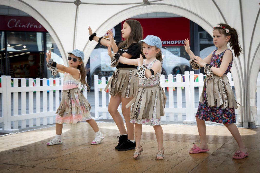 Young shoppers dance to African beat while raising money for centre which helps disabled children