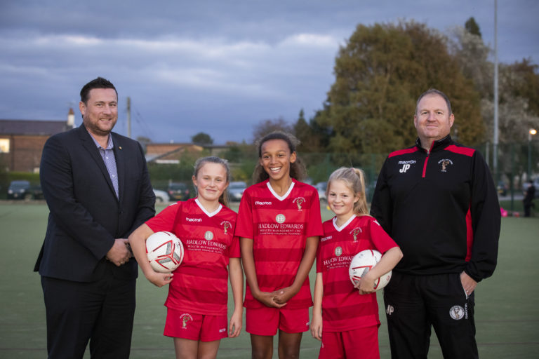 U12 girls football team net new kit thanks to Wrexham finance firm