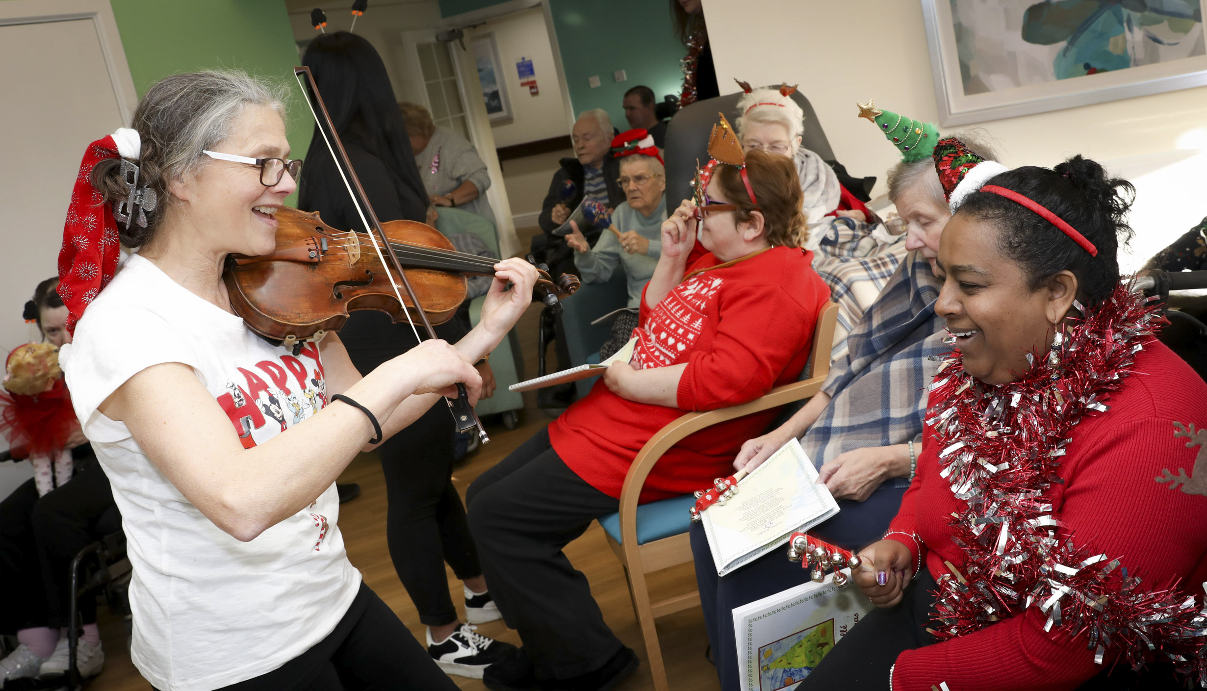 World class orchestra brings magic of Christmas to care home residents